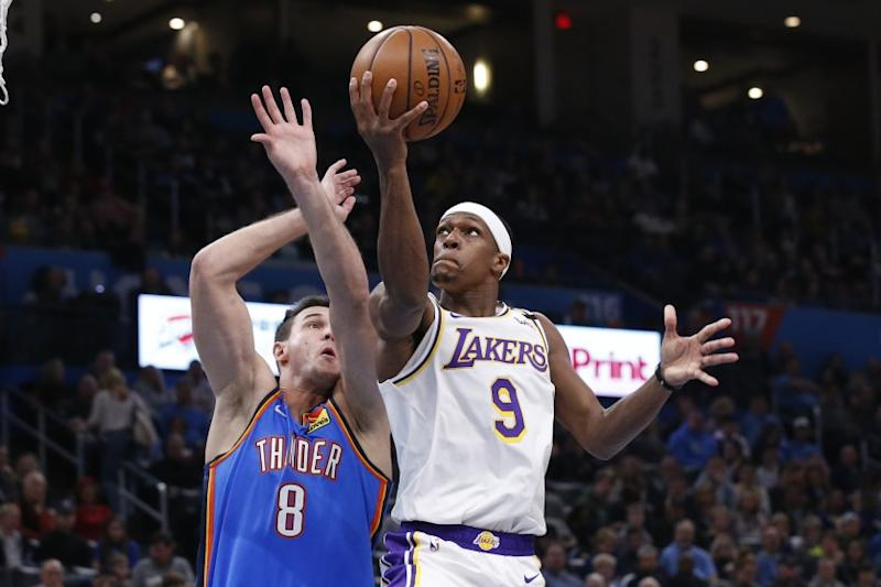 Lakers point guard Rajon Rondo attempts a layup against Thunder forward Danilo Gallinari during the first half of a game Jan. 11, 2020, in Oklahoma City.