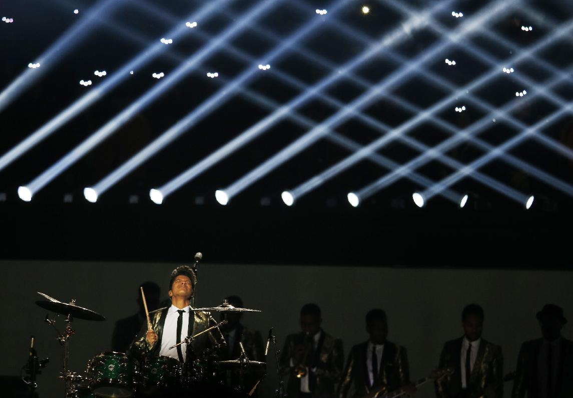Bruno Mars performs during the halftime show of the NFL Super Bowl XLVIII football game between the Seattle Seahawks and the Denver Broncos Sunday, Feb. 2, 2014, in East Rutherford, N.J. (AP Photo/Evan Vucci)
