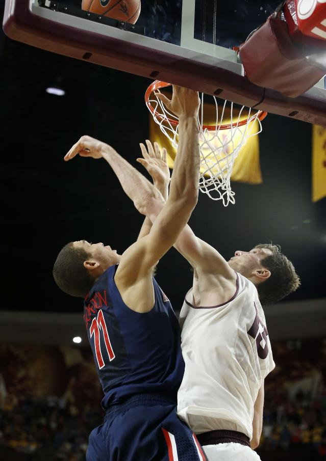 Arizona's Aaron Gordon (11) gets his shot blocked by Arizona State's Jordan Bachynski, right, during the second overtime of an NCAA college basketball game, Friday, Feb. 14, 2014, in Tempe, Ariz. Arizona State defeated Arizona 69-66 in double overtime. (AP Photo/Ross D. Franklin)