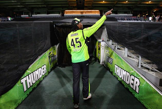 SYDNEY, AUSTRALIA - JANUARY 11:  Chris Gayle of the Thunder leaves the field after the T20 Big Bash League match between the Sydney Thunder and the Perth Scorchers at ANZ Stadium on January 11, 2012 in Sydney, Australia.  (Photo by Ryan Pierse/Getty Images)