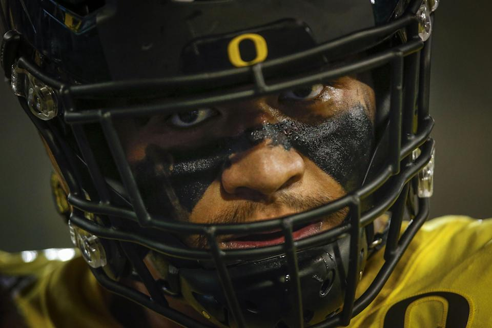 Oregon offensive tackle Penei Sewell, who won the Outland Trophy in 2019, will have a big decision to make between a possible 2021 spring season or entering next spring's NFL draft. [Andy Nelson/The Register-Guard] - registerguard.com