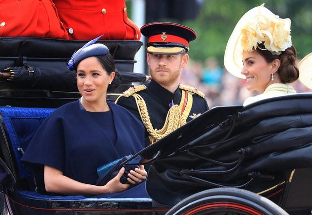 The Duke and Duchess of Sussex and the Duchess of Cambridge make their way along The Mall to Horse Guards Parade during the 2019 Trooping ceremony. Gareth Fuller/PA Wire