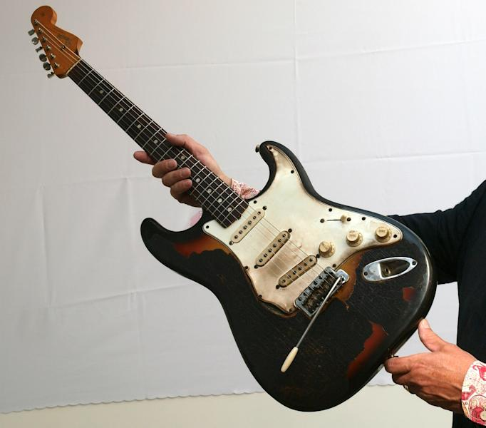FILE - In this July 24, 2008 file photo, the partly burnt 1965 Fender Stratocaster guitar which the late Jimi Hendrix set on fire during a concert at the London Astoria in 1967, is displayed in London before being auctioned on Sept. 4, 2008. Fender Musical Instruments, the maker of legendary guitars favored by the likes of Buddy Holly, Jimmy Hendrix and Eric Clapton, filed papers Thursday, March 8, 2012 for a $200 million initial public offering. (AP Photo/Max Nash, File)