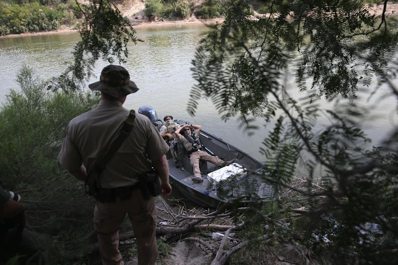 US law enforcement officers monitor the Rio Grande for immigrants illegally crossing from Mexico on July 24, 2014 in Mission, Texas (AFP Photo/John Moore)