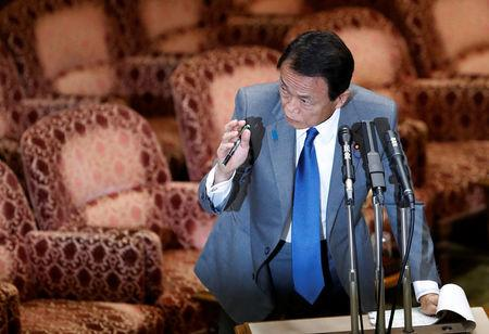 Japan's Finance Minister Taro Aso answers a question during an upper house parliamentary session in Tokyo