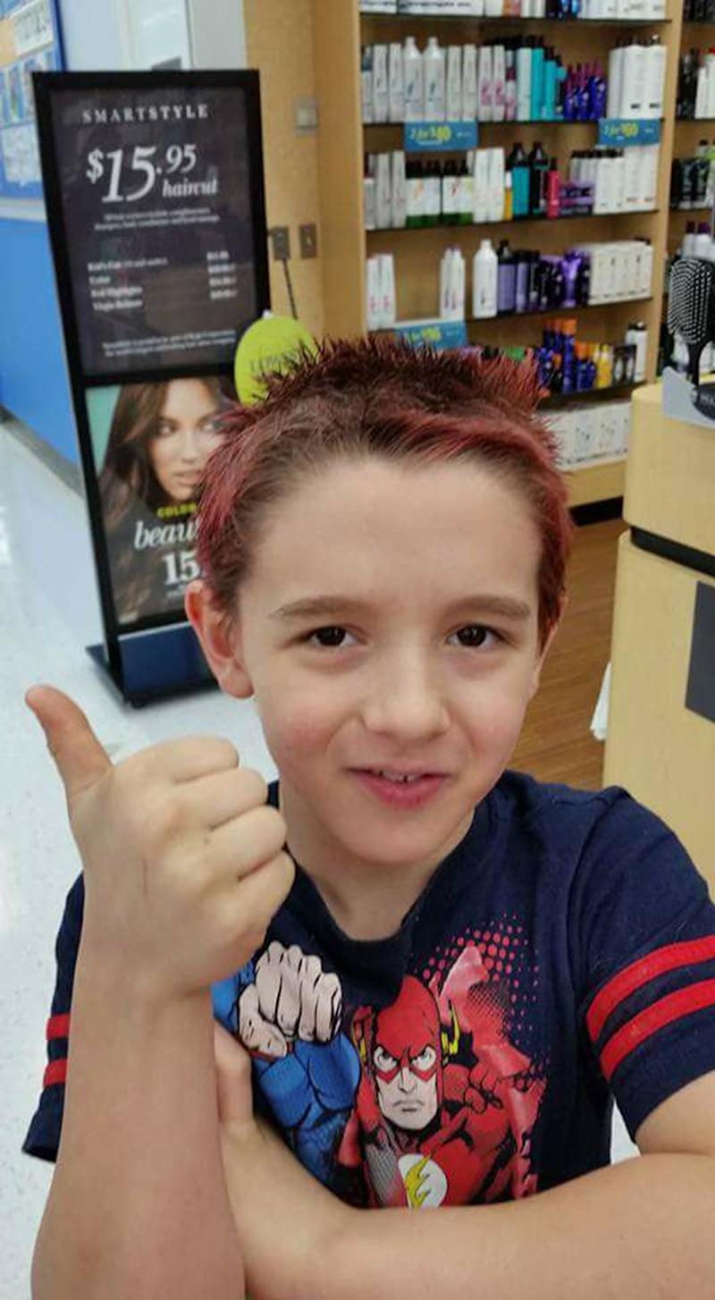 """Autism in our house is constant conversations about Minecraft and Skylanders. We are pretty proud of this photo. It was six years in the making. His last.hair cut at a salon was when he was 3 years old. He would go into meltdowns from the sensory overload of a haircut. In February 2017, he kept asking to dye his hair red, so we went back. He got a haircut and dye. He was so proud and so were we! He's 9 now, almost 10 and every day has its challenges, but every day I also see him persevere through uncomfortable sensory or social situations. He's come so far and we are beside him every step of the way!"""