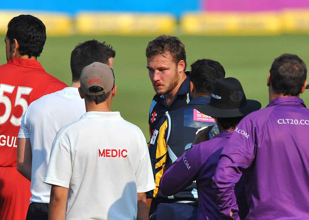 JOHANNESBURG, SOUTH AFRICA - OCTOBER 09:  David Miller of Yorkshire (C) sustains an injury to his face from a bouncer by Umar Gul during the Karbonn Smart CLT20 pre-tournament Qualifying Stage match between Yorkshire (England) and Uva Next (Sri Lanka) at Bidvest Wanderers Stadium on October 09, 2012 in Johannesburg, South Africa. (Photo by Duif du Toit/Gallo Images/Getty Images)