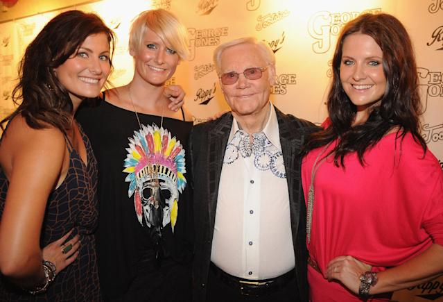 NASHVILLE, TN - SEPTEMBER 13: Country Sister Trio The McClymonts, Sam McClymont, Mollie McClymont, George Jones and Brooke McClymont attend George Jones' 80th birthday party at Rippy's Bar & Grill on September 13, 2011 in Nashville, Tennessee. (Photo by Rick Diamond/Getty Images)