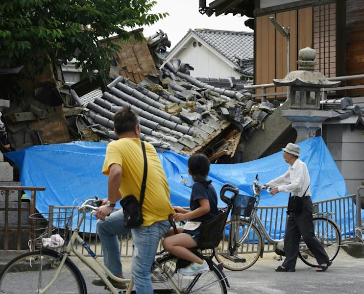 Japanese officials are working to quickly restore gas and running water to homes cut off after a powerful quake struck Osaka on Monday