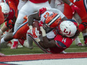 Syracuse running back Abdul Adams scores a touchdown as Liberty linebacker Solomon Ajayi defends during the first half of NCAA college football game in Lynchburg, Va. Saturday, Aug. 31, 2019. (AP Photo/Matt Bell)
