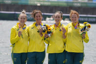 Lucy Stephan, Rosemary Popa, Jessica Morrison and Annabelle McIntyre, of Australia, pose with the gold medal following the women's rowing four final at the 2020 Summer Olympics, Wednesday, July 28, 2021, in Tokyo, Japan. (AP Photo/Darron Cummings)