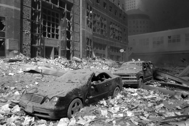 <p>The front of the World Financial Center is covered in debris in the aftermath of the Sept. 11 attacks in 2001. (Photo: Shawn Baldwin/AP) </p>