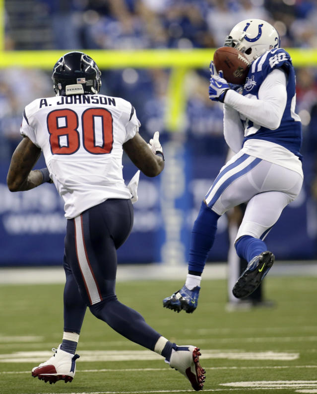Indianapolis Colts free safety Darius Butler, right, intercepts a pass intended for Houston Texans wide receiver Andre Johnson during the first half of an NFL football game in Indianapolis, Sunday, Dec. 15, 2013. (AP Photo/AJ Mast)