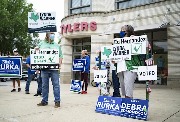 IMAGE: People hold campaign signs in municipal elections in Southlake, Texas, on May 1, 2021. (Nitashia Johnson / for NBC News)