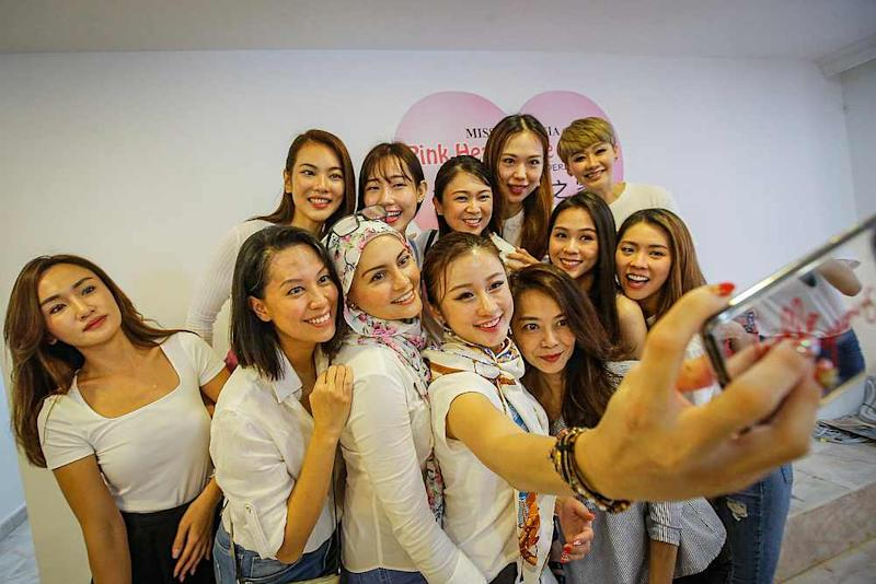 A group of former beauty queens at the Pink Heart Care Centre welfare home for the elderly. — Picture by Hari Anggara