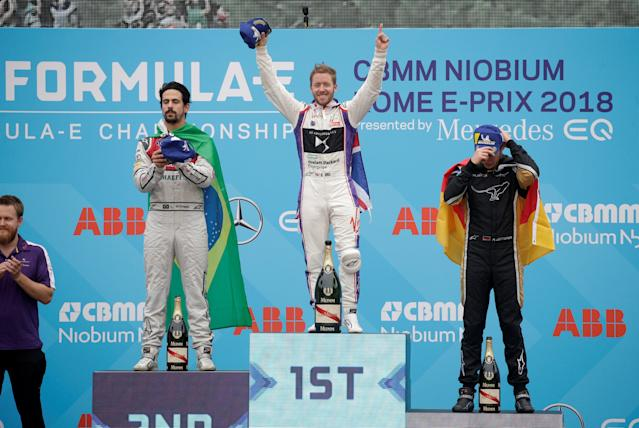 Motor Racing - Formula E - Rome ePrix - Rome, Italy - April 14, 2018 DS Virgin Racing's Sam Bird (C) celebrates winning the race with runner up Audi Sport Abt Schaeffler's Lucas Di Grassi (L) and third place Techeetah's Andre Lotterer (R) during the podium ceremony REUTERS/Max Rossi
