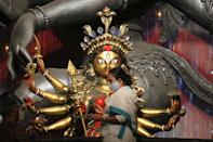WEST BENGAL, INDIA - 2020/10/12: West Bengal Chief Minister Mamata Banerjee visits Durga Puja pandal at Chetla Agrani Club and paints an eye of an idol of Goddess Durga in Kolkata. Banerjee, who was speaking after a cabinet meeting, said I ask everybody to follow the COVID-19 safety protocols during the festive season. There are instance of community transmission of COVID-19 and also the contagion becoming air borne.. (Photo by Dipa Chakraborty/Pacific Press/LightRocket via Getty Images)