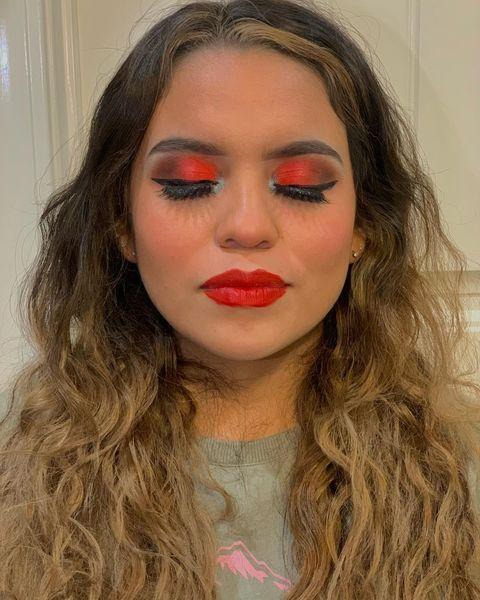 """<p>Here, traditional Christmas colors take on a sassy and sultry feel. A green-tinted highlight in the corners lightens things up, while a bold red lip grounds the look.</p><p><a class=""""link rapid-noclick-resp"""" href=""""https://www.amazon.com/NYX-Jumbo-Eye-Pencil-Sparkle/dp/B007448I1S/?tag=syn-yahoo-20&ascsubtag=%5Bartid%7C10050.g.34534998%5Bsrc%7Cyahoo-us"""" rel=""""nofollow noopener"""" target=""""_blank"""" data-ylk=""""slk:SHOP GREEN SPARKLE EYESHADOW PENCILS"""">SHOP GREEN SPARKLE EYESHADOW PENCILS</a></p><p><a href=""""https://www.instagram.com/p/CG8vBfQBXl9/?utm_source=ig_embed&utm_campaign=loading"""" rel=""""nofollow noopener"""" target=""""_blank"""" data-ylk=""""slk:See the original post on Instagram"""" class=""""link rapid-noclick-resp"""">See the original post on Instagram</a></p>"""