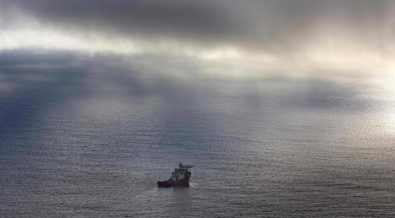 The Australian Defence Vessel Ocean Shield sails in the southern Indian Ocean as it continues to search for the missing Malaysia Airlines Flight MH370 in this picture released by the Australian Defence Force April 15, 2014. A U.S. Navy underwater drone sent to search for the missing Malaysian jetliner on the floor of the Indian Ocean had its first mission cut short after exceeding its 4.5 km (2.8 mile) depth limit, Australian search authorities said on Tuesday. REUTERS/Australian Defence Force/Handout via Reuters (MID-SEA - Tags: MILITARY TRANSPORT MARITIME IMAGES OF THE DAY) ATTENTION EDITORS - THIS PICTURE WAS PROVIDED BY A THIRD PARTY. REUTERS IS UNABLE TO INDEPENDENTLY VERIFY THE AUTHENTICITY, CONTENT, LOCATION OR DATE OF THIS IMAGE. THIS PICTURE IS DISTRIBUTED EXACTLY AS RECEIVED BY REUTERS, AS A SERVICE TO CLIENTS. NO SALES. NO ARCHIVES. FOR EDITORIAL USE ONLY. NOT FOR SALE FOR MARKETING OR ADVERTISING CAMPAIGNS