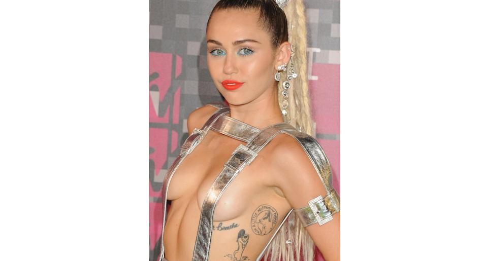 """Miley Cyrus's """"Just Breathe"""" tattoo is a tribute to her her deceased dog Floyd. (Getty Images)"""
