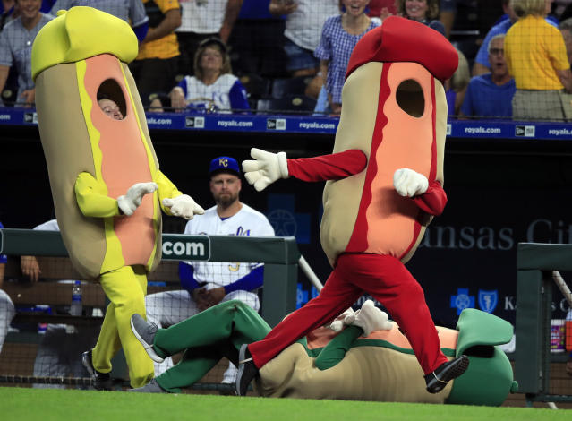 Ketchup and Mustard get around a fallen Relish during the hotdog race in the fourth inning of a baseball game between the Kansas City Royals and the Detroit Tigers at Kauffman Stadium in Kansas City, Mo., Friday, July 12, 2019. Ketchup won the race. (AP Photo/Orlin Wagner)