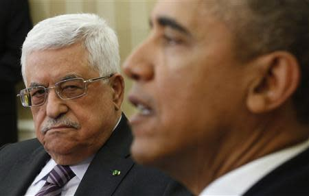 U.S. President Barack Obama meets with Palestinian Authority President Mahmoud Abbas (L) at the White House in Washington March 17, 2014. REUTERS/Kevin Lamarque