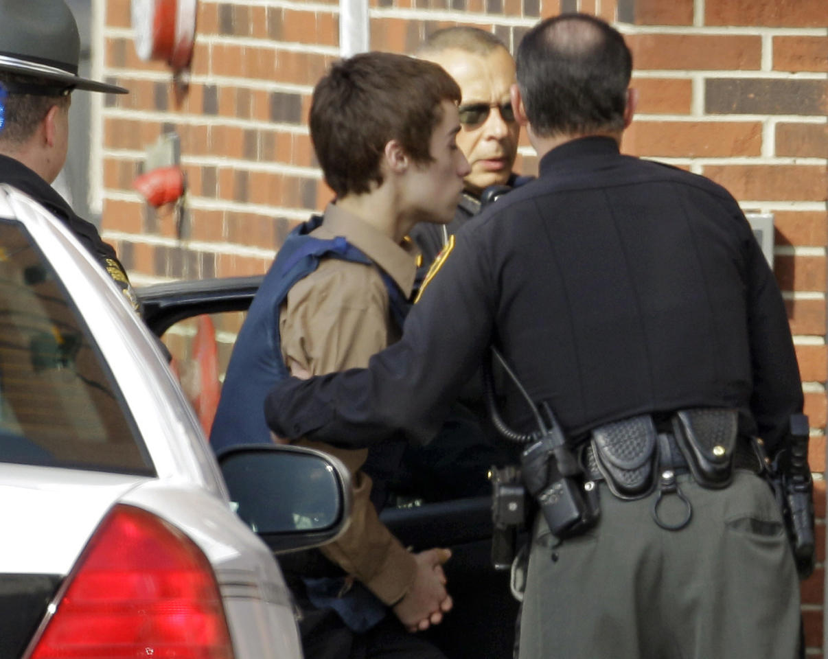T.J. Lane, a suspect in Monday's shooting of five students at Chardon High School is taken into juvenile court by Geauga County deputies in Chardon, Ohio Tuesday, Feb. 28, 2012. Three of the five students wounded in the attacks have since died. (AP Photo/Mark Duncan)