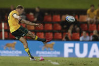 Australia's Reece Hodge attempts a penalty goal during their Tri-Nations rugby union match against Argentina in Newcastle, Australia, Saturday, Nov. 21, 2020. (AP Photo/Rick Rycroft)