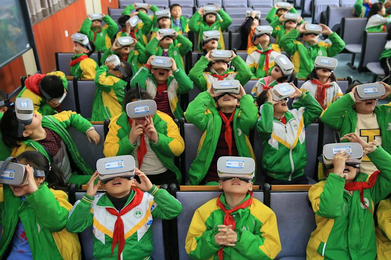 XIANGXI, CHINA - MARCH 14: Primary school students wear virtual reality glasses while learning about science in a classroom on March 14, 2018 in Xiangxi Tujia and Miao Autonomous Prefecture, Hunan Province of China. Virtual reality technology helps these primary school students better explore the secret of nature. (Photo by Visual China Group via Getty Images/Visual China Group via Getty Images)