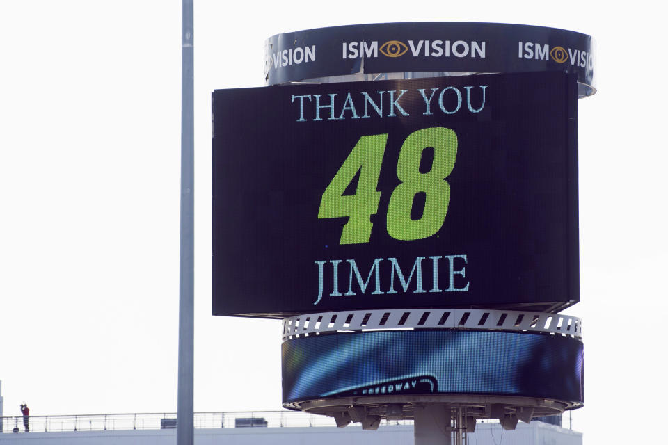 FILE - In this Sunday, Nov. 1, 2020, file photo, the jumbo screen in the infield pays tribute to Jimmie Johnson during a NASCAR Cup Series auto race at the Martinsville Speedway in Martinsville, Va. Johnson is retiring from full-time NASCAR competition in Sunday's season finale at Phoenix Raceway, leaving the sport as a seven-time champion ranked sixth on the all-time wins list with 83 career victories. (AP Photo/Lee Luther Jr., File)