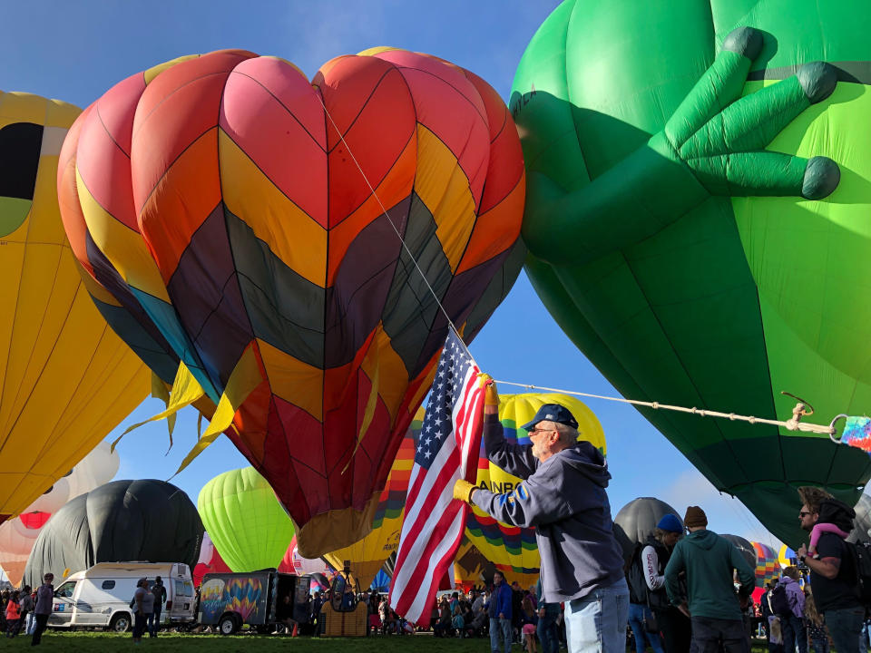 FILE - In this Oct. 5, 2019, file photo, hot air balloons are inflated during the annual Albuquerque International Balloon Fiesta in Albuquerque, N.M. The Albuquerque International Balloon Fiesta is returning after a pandemic hiatus with plans to launch about 540 hot-air balloons in a stunning visual spectacle. The nine-day event starts Saturday, Oct. 2, 2021. (AP Photo/Susan Montoya Bryan, File)