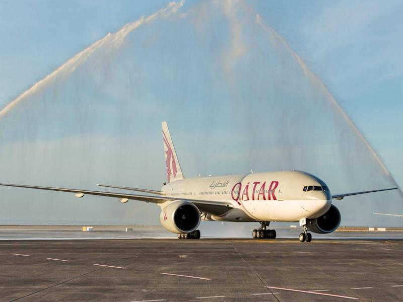 Auckland Airport welcomed the first Qatar Airways flight with a traditional water cannon salute (Reuters)