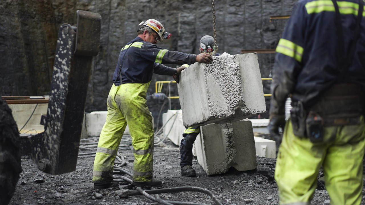 <p> FILE - In this Wednesday, June 7, 2017, file photo, a worker lowers a concrete block at the site of a new coal mine in Friedens, Pa. On Friday, Dec. 15, 2017, the Federal Reserve said mining activity climbed 2 percent in November, while manufacturing activity rose 0.2 percent. (AP Photo/Dake Kang, File) </p>
