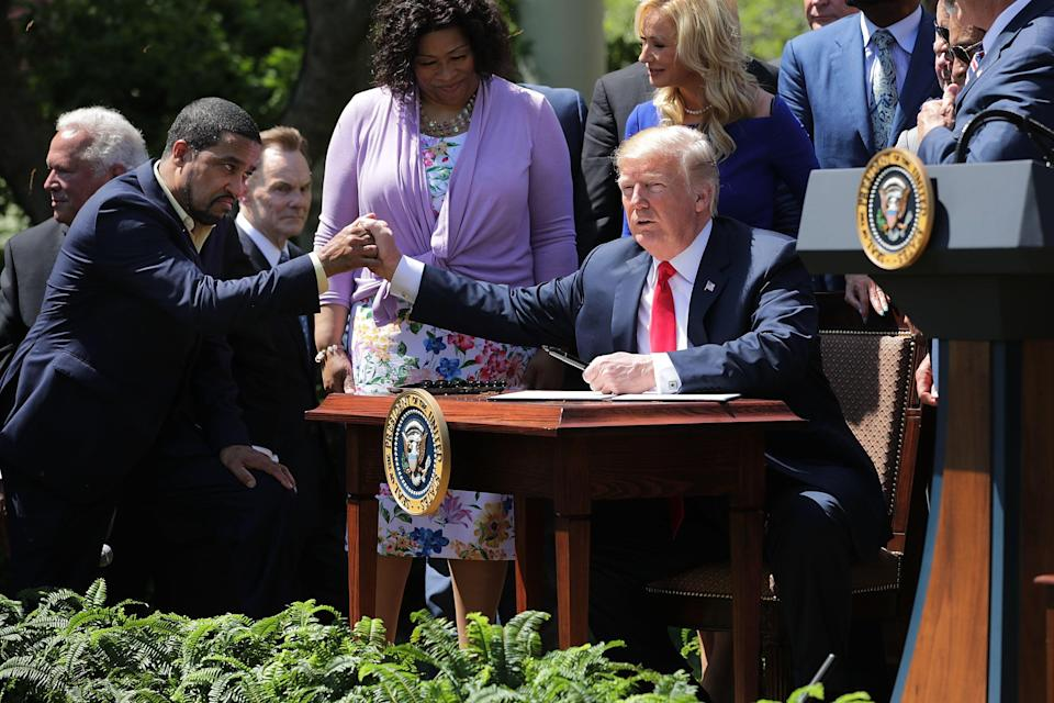 Rev. Darrell Scott, left, says President Trump is on board with a series of racial summits this summer. (Getty)