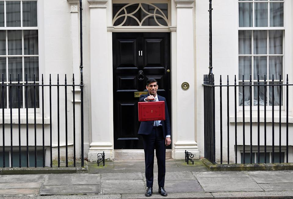 Chancellor of the Exchequer Rishi Sunak poses with a red briefcase outside his office in Downing Street in London, in March (Photo: Toby Melville / Reuters)