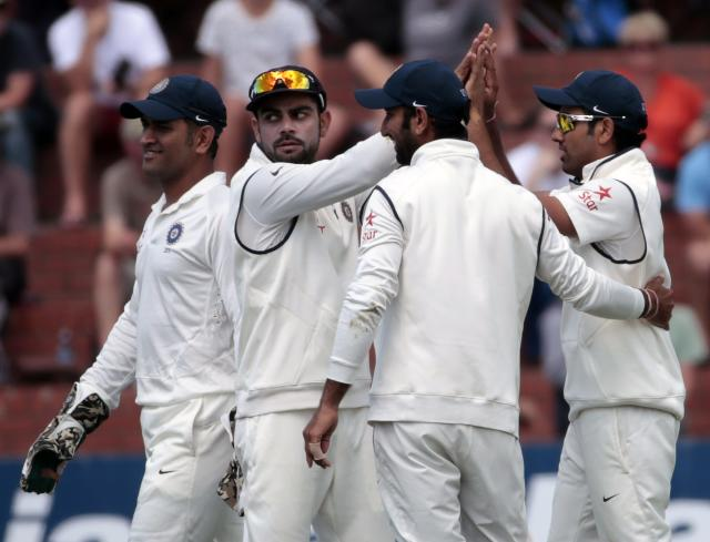 India's players celebrate the dismissal of New Zealand's Kane Williamson during day one of the second international test cricket match at the Basin Reserve in Wellington, February 14, 2014. REUTERS/Anthony Phelps (NEW ZEALAND - Tags: SPORT CRICKET)