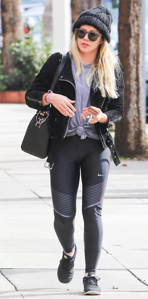 """<p>The <em>Younger </em>actress bundled up for a chilly day in L.A. wearing a knotted gray tee, black Nike leggings ($90; <a rel=""""nofollow"""" href=""""https://click.linksynergy.com/fs-bin/click?id=93xLBvPhAeE&subid=0&offerid=489843.1&type=10&tmpid=12957&RD_PARM1=http%3A%2F%2Fstore.nike.com%2Fus%2Fen_us%2Fpd%2Fpower-speed-womens-running-tights%2Fpid-11104541%2Fpgid-11494319&u1=ISNewsHilaryDuffStreetstyle3.13JA"""">nike.com</a>), and black Nike sneakers. She kept warm with a black jacket and gray beanie. </p>"""