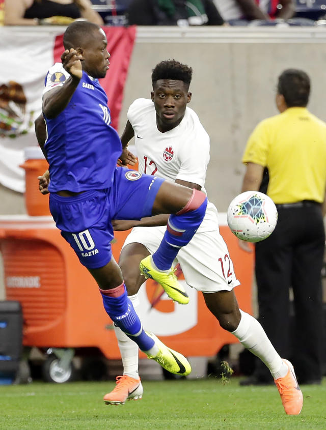 Haiti midfielder Wilde-Donald Guerrier (10) brings down the ball in front of Canada midfielder Alphonso Davies (12) during the first half of a CONCACAF Gold Cup soccer quarterfinal Saturday, June 29, 2019, in Houston. (AP Photo/Michael Wyke)
