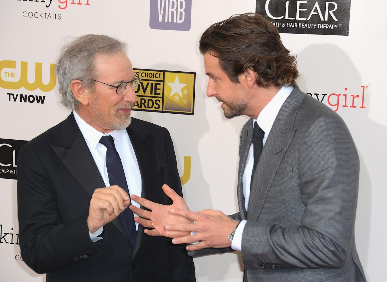 SANTA MONICA, CA - JANUARY 10: Director Steven Spielberg and actor Bradley Cooper arrive at the 18th Annual Critics' Choice Movie Awards at Barker Hangar on January 10, 2013 in Santa Monica, California.  (Photo by Frazer Harrison/Getty Images)