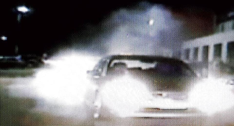 CCTV shows a Holden Calais doing burnouts in a Liverpool carpark. Police have charged a 23-year-old woman for allegedly doing burnouts in the carpark with a 10-month-old child in the back seat.