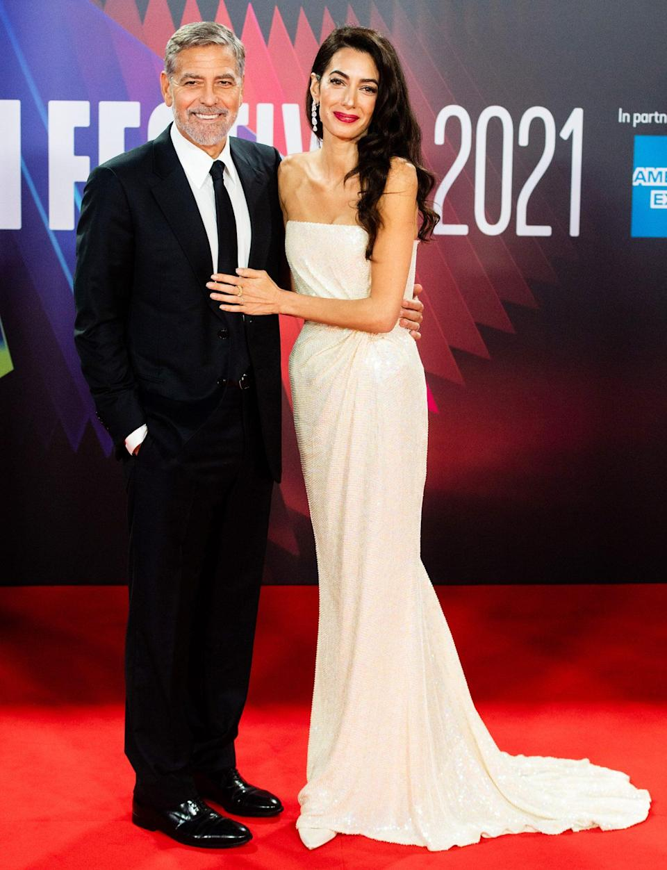 <p>George and Amal Clooney light up <em>The Tender Bar</em> premiere red carpet during the 65th BFI London Film Festival on Oct. 10.</p>
