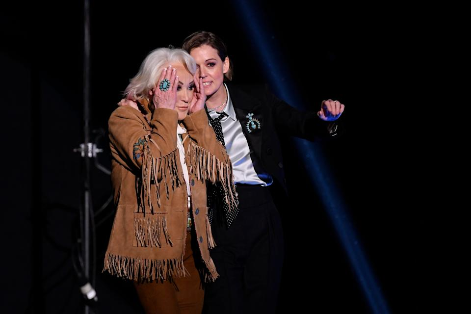 """Tanya Tucker (left, with Brandi Carlile) reacts when she's announced as the winner of best country album for """"While I'm Livin' """" during the 62nd annual Grammy Awards."""
