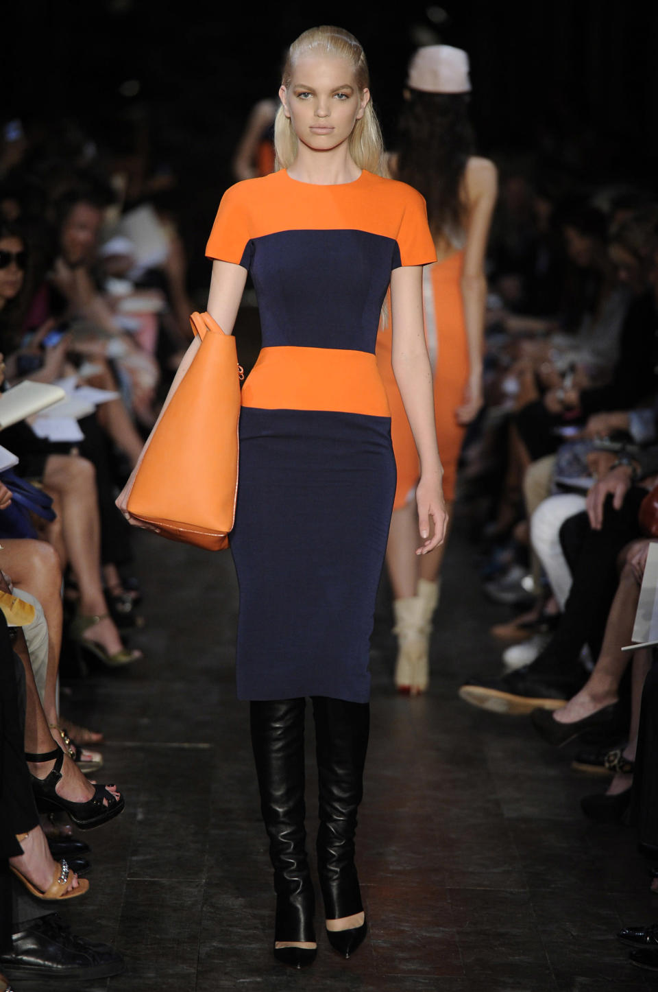 <p>On September 11 2011, Beckham showcased the SS12 collection and it was a swift move away from her signature figure-skimming looks. Instead, models graced the runway in A-line mini dresses and roomy anoraks. <em>[Photo: Getty]</em> </p>