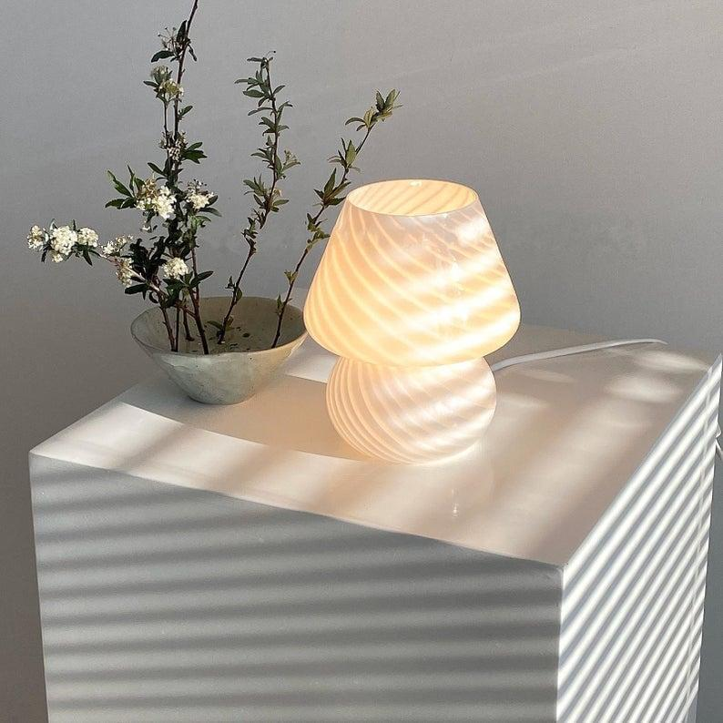 <p>You've likely seen this trendy <span>Etsy Baby Mushroom Glass Stripe Desk Lamp</span> ($169, originally $188) on your Instagram feed, and now you can have one, too.</p>