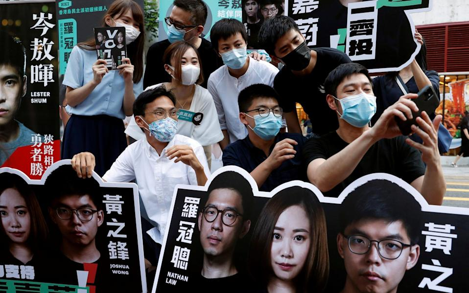 Pro-democracy parties in Hong Kong held primary polls on July 11 despite warnings from government officials that it may be in breach of a new security law - Reuters