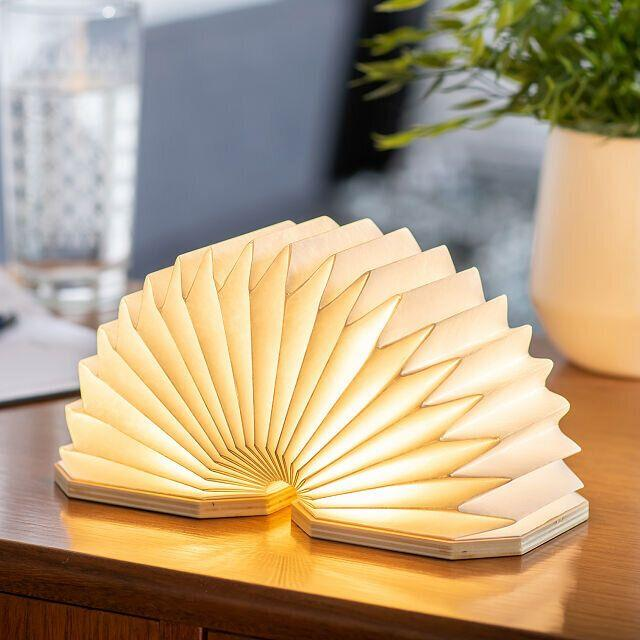"""If you're a creative who craves a lamp that isn't like the others, you could get this sculptural one that's shaped like an accordion. It can be compressed down when you're not using it and pressed up when you need it. This lamp uses amicro usb charging cable, which is included. <a href=""""https://fave.co/35Rpsl5"""" target=""""_blank"""" rel=""""noopener noreferrer"""">Find it for $69 at Uncommon Goods</a>."""