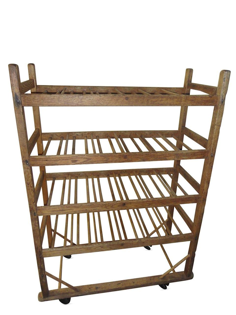 """<p>Appraiser Bene Raia of Raia Auctioneers says your rolling rack is an Early-20th-Century Baker's Rack that was used in the factory of a bread company. """"The rack's open shelves were essential for letting air circulate around the freshly baked loaves, and the four steel casters allowed the bread to be moved quickly to packaging and distribution areas,"""" she says. The primary wood material is oak along with some other mixed woods. Bene adds that the fact that your rack has been stripped and stained has minor impact on its value, because these pieces were produced in great quantity and are therefore not particularly rare.</p><p><strong>What it's worth: </strong>$300 <em>($425 in original condition)</em></p>"""