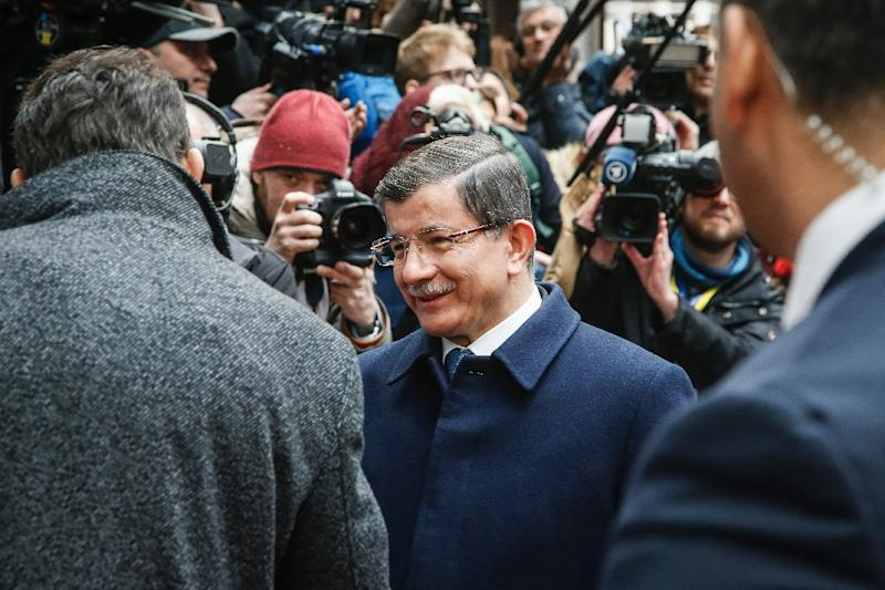 Turkish Prime Minister Ahmet Davutoglu arrives at a European Union leaders' summit with Turkey on the migrants crisis in Brussels, on March 7, 2016 (AFP Photo/Thierry Roge)
