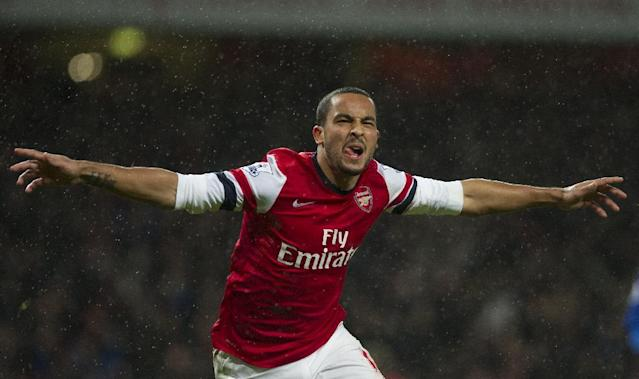 Arsenal's Theo Walcott reacts after scoring against Cardiff City during their English Premier League match, at Emirates Stadium, in London, Wednesday, Jan. 1, 2014. (AP Photo/Bogdan Maran)