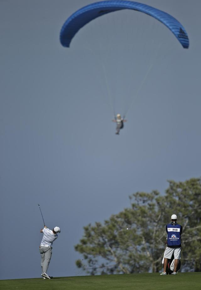 Jordan Spieth hits his second shot to the fourth hole on the south course at Torrey Pines during the first round of the Farmers Insurance Open golf tournament Thursday, Jan. 23, 2014, in San Diego. (AP Photo/Lenny Ignelzi)